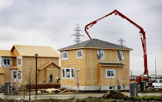 Contractors work building new homes amidst the rain in Bridgewater