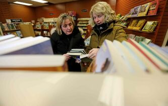 Barb Polson and Carol Douglas shop at Hull's Family Book Store on Thursday.