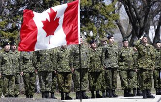 Lt. Col. Mike Lane, PPCLI, salutes with 38 Canadian Brigade Group at the Brookside  Cemetery ceremony in Winnipeg as part of the National Day of Honour.