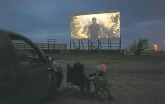 Melissa Tait / Winnipeg Free Press  A family watches a show at the Stardust Drive-In in Morden. People want to get out again.