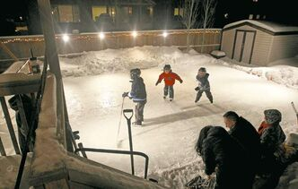 The kids have jun on a backyard rink at a home in Winnipeg's royalwood subdivision. University of Guelph scientists want to know how climate affects such rinks.