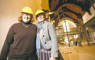 Reverand Cathy Campbell (left) and Angie Jantz inside St. Matthews Anglican Church, where renovations are underway to convert the space into 26 apartments.