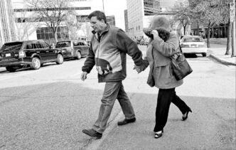 Glen Abraham and wife Debbie MacPhail-Abraham leave the Law Courts Building after testifying Thursday at the Sinclair inquest.  Glen Abraham and wife Debbie MacPhaill- Abraham leave the Lawcourts building where they were testifying during the Brian Sinclair Inquiry. They are the couple who first noticed and told security about a man they didn�t think was breathing in the waiting room. 131024 - October 24, 2013 MIKE DEAL / WINNIPEG FREE PRESS