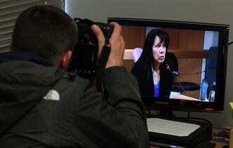 A photographer shoots a video monitor as Lila Purcell testifies at the Missing Women Inquiry in Vancouver, Monday, April 16, 2012. Lila Purcell is the aunt of victim Tanya Holyk. THE CANADIAN PRESS/Jonathan Hayward