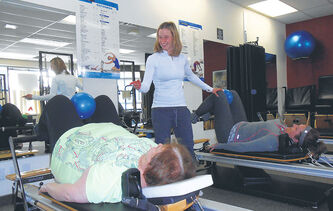 Instructor Nicole Mulder puts participants throught their paces at a plus-size Pilates class at the Pilates Manitoba Wellness Centre.