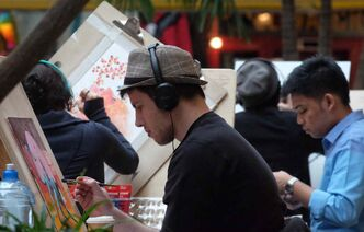 Red River College graphic design students create original works of art over the weekend during the 12th annual Student Art Show and Auction at The Forks.