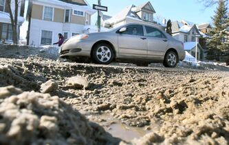Motorists swerve to miss a massive pothole that developed on Maryland Street at Sara Avenue last week.