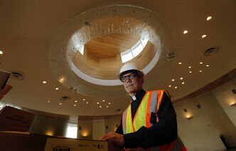 Faith .Rev. Darren Gurr can't wait to doff the hardhat and safety gear for his first service at brand-new St. Gianna Berra Molla in Whyte Ridge.