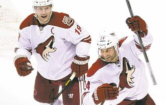 Coyotes Kyle Chipchura (right) and Shane Doan may be celebrating a goal, but they could just as well be celebrating a deal likely to keep them in Arizona.
