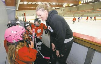 Sami Jo Small speaks with students in her hockey school at the Gateway Community Centre arena Wednesday.