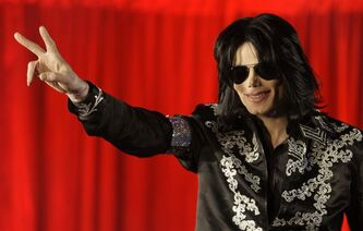 "FILE - - In this March 5, 2009 file photo, US singer Michael Jackson announces at a press conference that he is set to play ten live concerts at the London O2 Arena in July 2009. David Berman, a recording industry expert hired by Jackson's mother, Katherine, testified Monday June 17, 2013, that concert promoter AEG Live LLC created a conflict of interest by negotiating with the singer's physician for services on the ""This Is It"" tour. Katherine Jackson is suing AEG Live, claiming it failed to properly investigate the doctor and ignored warning signs about her son's health before his death on June 25, 2009. (AP Photo/Joel Ryan, File)"