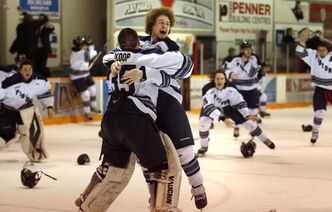 Steinbach Pistons defenceman Taylor Friesen embraces netminder Corey Koop after the Pistons claimed the Turnbull Cup as MJHL champions with a 3-2 win over the visiting Dauphin Kings Wednesday night.