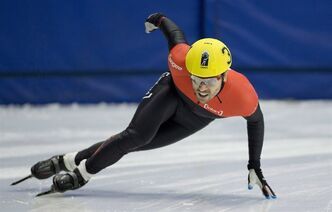 Francois-Louis Tremblay takes a turn during heat four of the men's 500-metre race at the 2014 Canadian short track speedskating team selections in Montreal, Monday, August 12, 2013. Tremblay is ending a career that saw him win five Olympic medals.Tremblay failed in his bid to make the Canadian team for the Sochi Olympics next February. THE CANADIAN PRESS/Graham Hughes