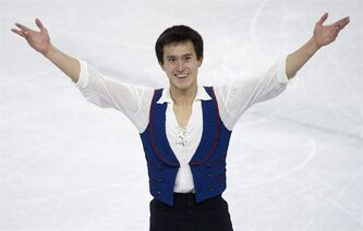 Patrick Chan of Canada salutes the crowd after performing in the men's free program as the ISU World Figure Skating Championshipsin London, Ontario on Friday March 15, 2013. THE CANADIAN PRESS/Frank Gunn