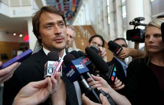 Teemu Selanne, who says he considered Baizley his 'Canadian dad,' speaks with news media at the MTS Centre service.