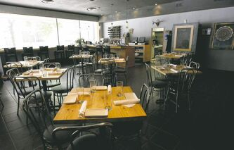 The decor inside Deer + Almond is modern, with comfortable chairs and tall stools at the bar.