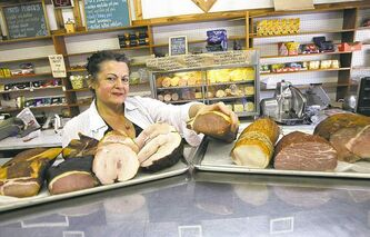 Barb Funk, owner of the Ellice Meat Market, with store-made cold cuts.
