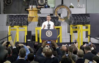 President Barack Obama speaks to workers and guests at the Linamar Corporation plant in Arden, N.C., Wednesday, Feb. 13, 2013, as he travels after delivering his State of the Union address Tuesday. (AP Photo/Chuck Burton)