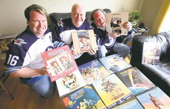 Blaine Martin (left), his dad Byron (centre) and brother Brent collect LaserDiscs.Some rare LaserDisc box sets can go for hundreds of dollars.