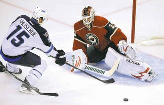 photos by tom olmscheid / the associated press