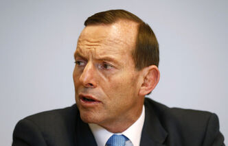 Australian Prime Minister-elect Tony Abbott meets with Treasury Secretary Martin Parkinson, in Sydney Sunday.