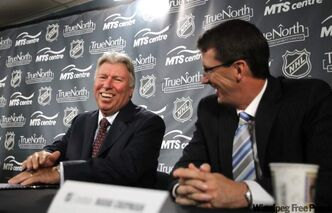 At left, Pierre Blouin, chief executive officer MTS Allstream Inc., and Mark Chipman, chairman of True North Sports and Entertainment.