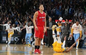Los Angeles Clippers forward Blake Griffin, front, reacts as Denver Nuggets guard Randy Foye, celebrates after hitting a 3-point basket with nine-tenths of second remaining in the fourth quarter of the Nuggets' 116-115 victory in an NBA basketball game in Denver, Monday, Feb. 3, 2014. (AP Photo/David Zalubowski)
