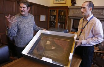 "In this Oct. 29, 2013, photo taken in Evanston, Ill., Scott Krafft, left, curator of the Charles Deering McCormick Library of Special Collections, and manuscript librarian Benn Joseph display a painting of a dead Spanish boy from the 1,600s. The portrait is one of the artifacts from the ""Death Collection""- an archive of death-related oddities once owned by horror novelist and screenwriter Michael McEachern McDowell that have been purchased by Northwestern University. (AP Photo/M. Spencer Green)"