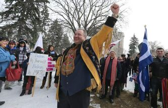 Fist in the air: MMF president David Chartrand celebrates at St. Boniface Cathedral Cemetery near the gravesite of Louis Riel, Saturday.
