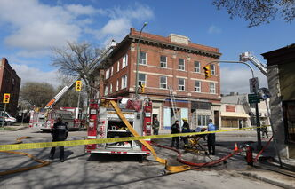 Firefighters work at the scene of a blaze Wednesday in the Rubin apartment block at Morley Avenue and Osborne Street.