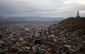 "A large statue of the Virgin Maria holding a baby Jesus, known as the Virgen del Socav�n, stands on Santa Barbara hill overlooking the mining city of Oruro, Bolivia, as it is unveiled for the first time on Friday, Feb. 1, 2013. The virgin, known in Spanish as ""Virgen del Socav�n,"" or the Virgin of the Tunnel, is Oruro's patron, venerated in particular by miners and folkloric Carnival dancers. (AP Photo/Juan Karita)"
