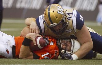 IT WASN'T ALL BAD: Winnipeg Blue Bomber Zach Anderson sacks B.C Lions quarterback Travis Lulay during the first half of their game in Vancouver on Monday.