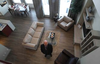 Realtor Alan Ediger in a Sage Creek home listed at $850,000. He says interest rates mean more buying power.