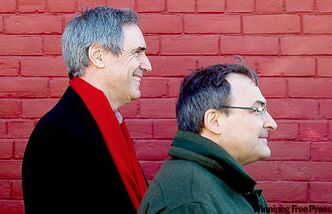Michael Ignatieff (left) and Liberal candidate Martin Cauchon campaign in Montreal.