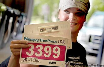 Tiffany Cook holds a pair of Manitoba Marathon bibs showing the new 'chip.'