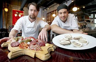 Peasant Cookery's Tristan Foucault, left, with Charcuterie (a selection of house made sausages, pates, and terrines), and Chef de cuisine Chris Gama with Village Bay Oysters.