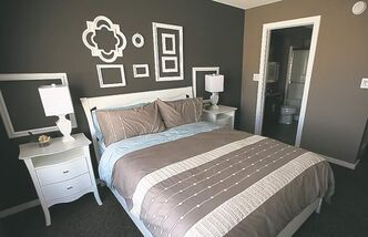 The master bedroom (right) features a spacious three-piece ensuite with five-foot shower, dark maple vanity and his-and-her closets.