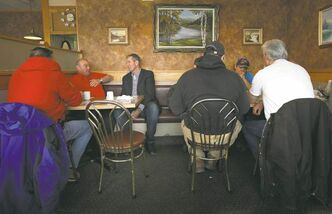 Pallister meets with both friends and foes at a coffee shop in Portage La Prairie.