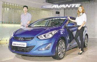 Hyundai has revealed its remodelled Elantra. Its new front bumper and grille  along with a light tube ringing the projection lamps freshens the front end's look.