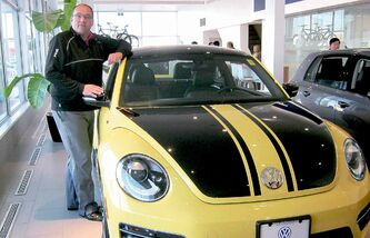 Auto Haus Volkswagen cleint advisor Joe Scott with limited edition 2014 Volkswagen Beetle GSR.