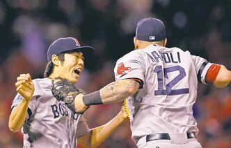 Boston Red Sox closer Koji Uehara (left) and Mike Napoli celebrate victory in Game 4 in St. Louis Sunday night.