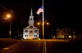 In this Dec. 15, 2012 file photo, a U.S. flag flies at half-staff on Main Street in honor of the 26 people killed when gunman Adam Lanza opened fire inside a Sandy Hook Elementary School on Dec. 14, 2012, in Newtown.