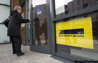 A woman arrives to cast her vote in Canada's federal election in Montreal, Monday. THE CANADIAN PRESS/