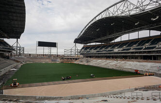 The final piece of artificial turf was laid down to create the new field for the Blue Bombers at Investors Group Field.
