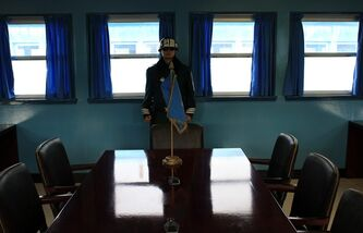 A South Korean soldier stands inside the Military Armistice Committee meeting room at the border village of Panmunjom (DMZ) that separates the two Koreas since the Korean War, in Paju, north of Seoul, South Korea, Tuesday, March 19, 2013. The United States is flying nuclear-capable B-52 bombers on training missions over South Korea to highlight Washington's commitment to defend an ally amid rising tensions with North Korea, Pentagon officials said Monday.(AP Photo/Lee Jin-man)