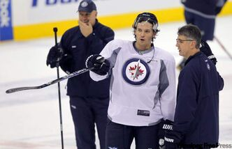 Ron Hainsey talks to Winnipeg Jets head coach Claude Noel at practice Monday.