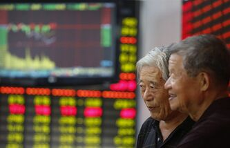 Investors look at the stock price monitor at a private securities company in Shanghai, China, Wednesday, July 24, 2013. Asian stock markets were mostly lower Wednesday after a survey showed Chinese manufacturing fell to its lowest point in nearly a year. (AP Photo)