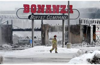 Firefighters at the scene of a Christmas day fire at the Bonanza Buffet restaurant at 137 Avenue and 127 Street in Edmonton on Tuesday.