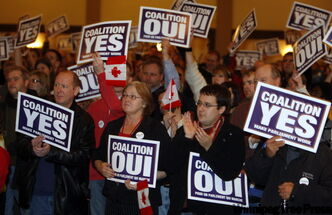 Liberals, New Democrats, labour officials, academics and many others took part in a pro-coalition rally at the Malborough Hotel in Winnipeg.