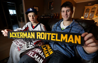 Ackerman-Roitelman shoots... Ackerman-Roitelman scores!: Dustin (left) and Evan have had quite a mouthful on the backs of their hockey jerseys.